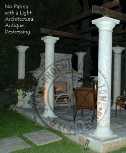 You are looking at new hand carved columns with no patina and a light architectural antique destressed finish